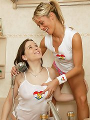 Two girls toying pussy in a bath