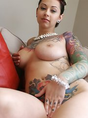Astounding crazy chick with amazing naturals shows off her countless tattoos all over her body
