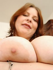 Silvi plays with her big hooters and dildo fucking her pussy