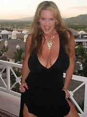 In Mexico, Kelly makes a big cock cum all of her titties.