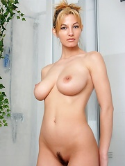 Tall blonde gets her big tits wet in the shower